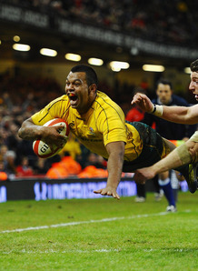 Aussie Kurtley Beale scores a try against Wales last weekend. Australia has cemented their place at Band One after the win. Photo: Planet Rugby