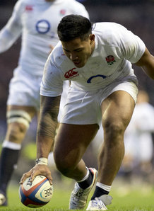 English centre Manu Tuilagi touches down against New Zealand. England beat the All Blacks 38-21 on Sunday. Photo: Planet Rugby
