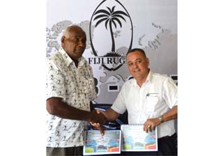FRU official Ilaitia Tuisese and Carpenters Moyors general manager Roger Powell shake hands during the signing of the deal in Suva. Photo: FRU