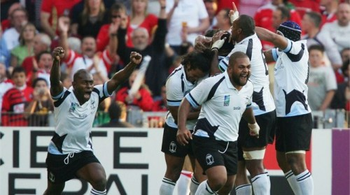 Fiji celebrate after Graham Dewes burrows over to score the match winning try during the Rugby World Cup 2007 Pool B match against Wales. Photo: Getty Images