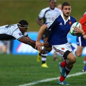 Valenin Saurs of France busts through the Fijian defence at the IRB Junior World Championship 2014 in New Zealand. Photo: IRB