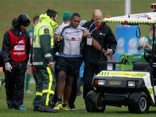 Fijian lock Penioni Toga is escorted off the field after sustaining an injury against Ireland on Tuesday. Photo: Planet Rugby