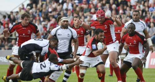 Phil Mack attacks against Fiji in their PNC clash last year. Photo: Ottawa Citizen