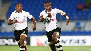 Benedito Masilevu (R) leads an attack for Fiji. Photo: News Limited