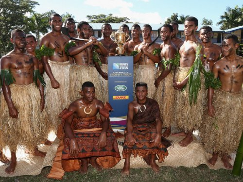 Students of Ratu Navula Secondary School pose with the William Webb Ellis Cup after performing a welcome ceremony. Photo: IRB
