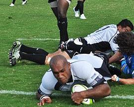 Flying Fijian inside centre Nemani Nadolo scores the hosts opening try against Italy at the ANZ Stadium in Suva. Photo: RugbyLive