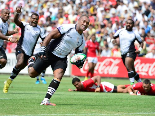 Flying Fijian Nemani Nadolo punches through a gap against Tonga at Churchill Park. Photo: Planet Rugby