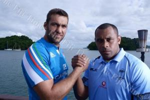 Fiji skipper Akapusi Qera (R) shakes the hand of his Italian counterpart Quintin Geldenhuys at the Novotel Hotel in Lami yesterday. Photo: Fiji Times