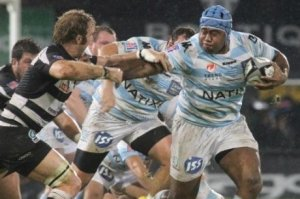 Jone Qovu powers his way forward for Racing Metro. Photo: AFP