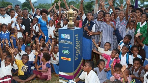 Local youngsters show their excitement at the arrival of the Webb Ellis Cup in Fiji. Photo: IRB