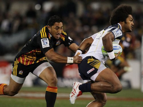 Henry Speight attacks for the Brumbies against Bundee Aki of the Chiefs. Photo: Skysports