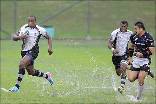 Flying Fijian Sireli Bobo runs away from the Japanese in an earlier PNC match. Photo: Zoom Fiji