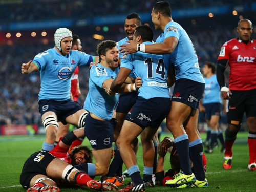 Tahs' celebrate Adam Ashley-Cooper's (getting off the deck) try. Photo: Skysports