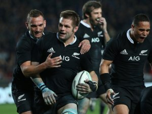 All Blacks skipper Richie McCaw is congratulated by Aaron Cruden after scoring a try against Australia. Photo: Planet Rugby