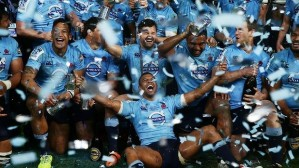 Kurtley Beale (on deck) celebrates with the Waratahs after defeating the Crusaders in the Super Rugby final. Photo: Getty Images
