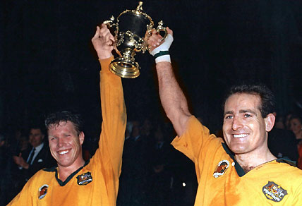 Farr-Jones and Campese lift the Webb-Ellis Cup in 1991. Photo: AAP