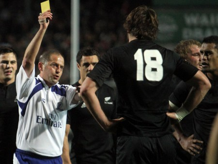 Referee Jonathan Kaplan shows Sam Whitelock the yellow card. Photo: Skysports