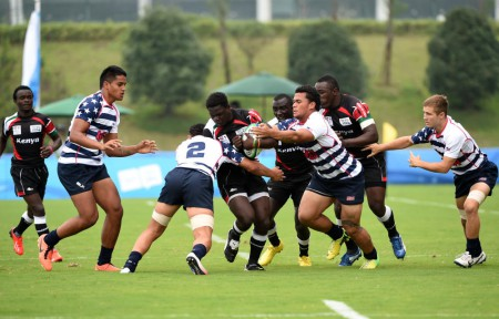 Kenyan players face the solid defence of the United States at Nanjing 2014 Youth Olympic Games in Nanjing, capital of east China's Jiangsu Province. Kenya won 22-12. Photo: Xinhua/Yan Yan (yqq)