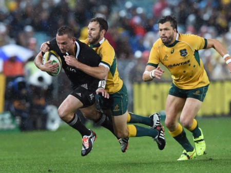 All Blacks Aaron Cruden is tackled by Nic White in the 12-12 even match last night in Sydney. Photo: Skysports