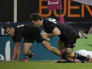 Winger Ben Smith crosses against Argentina . Photo: Skysports