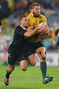 Slipper takes Aaron Cruden for the ride in Bledisloe I this year. Photo: Getty Images