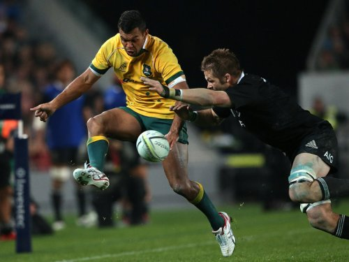 Kurtley Beale is challenged by Richie McCaw. Photo: Skysports