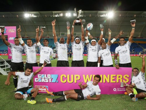 Fiji acknowledge the crowd with the spoils of the Gold Coast Sevens win. Photo: IRB