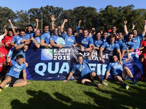 Uruguay celebrate after securing their berth to join England, Australia, Wales and Fiji in Pool A of the 2015 England tournament. Photo: Planet Rugby