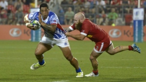 Samoan Anthony Perenise evades a tackle from Canadian Ray Barkwill in their match in Toronto. Photo: The Canadian Press