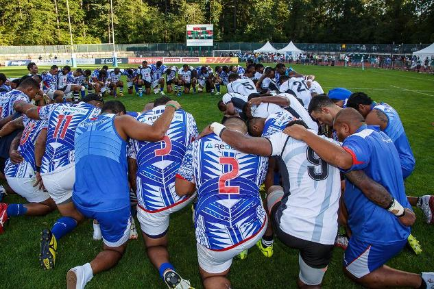 Manu Samoa and Fijian players pray after the PNC final in Burnaby, BC last Tuesday. Photo: World Rugby