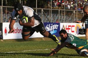 Skipper Akapusi Qera overcomes the opposition against the Cook Islands during Fiji's qualifications matches to the 2015 Rugby World Cup. Photo: World Rugby