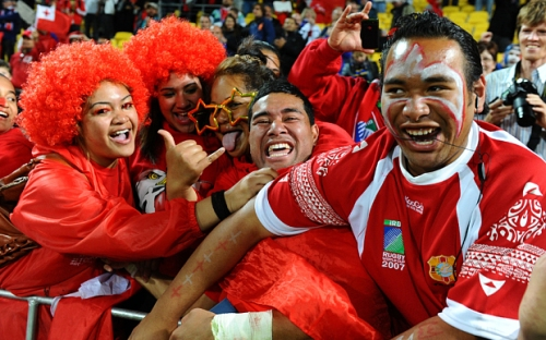 Centre Siale Piutau of Tonga celebrates with the fans following his team's 19-14 victory during the IRB 2011 Rugby World Cup Pool A match between France and Tonga at Wellington, New Zealand.  (Photo by Mike Hewitt/Getty Images)
