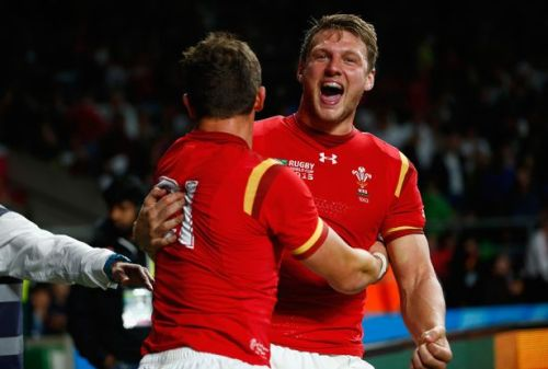 Wales flyhald Dan Biggar (right) celebrates one of his penalty kicks with Lloyd Williams in their 28-25 win over England on Sunday. Photo: WalesOnline
