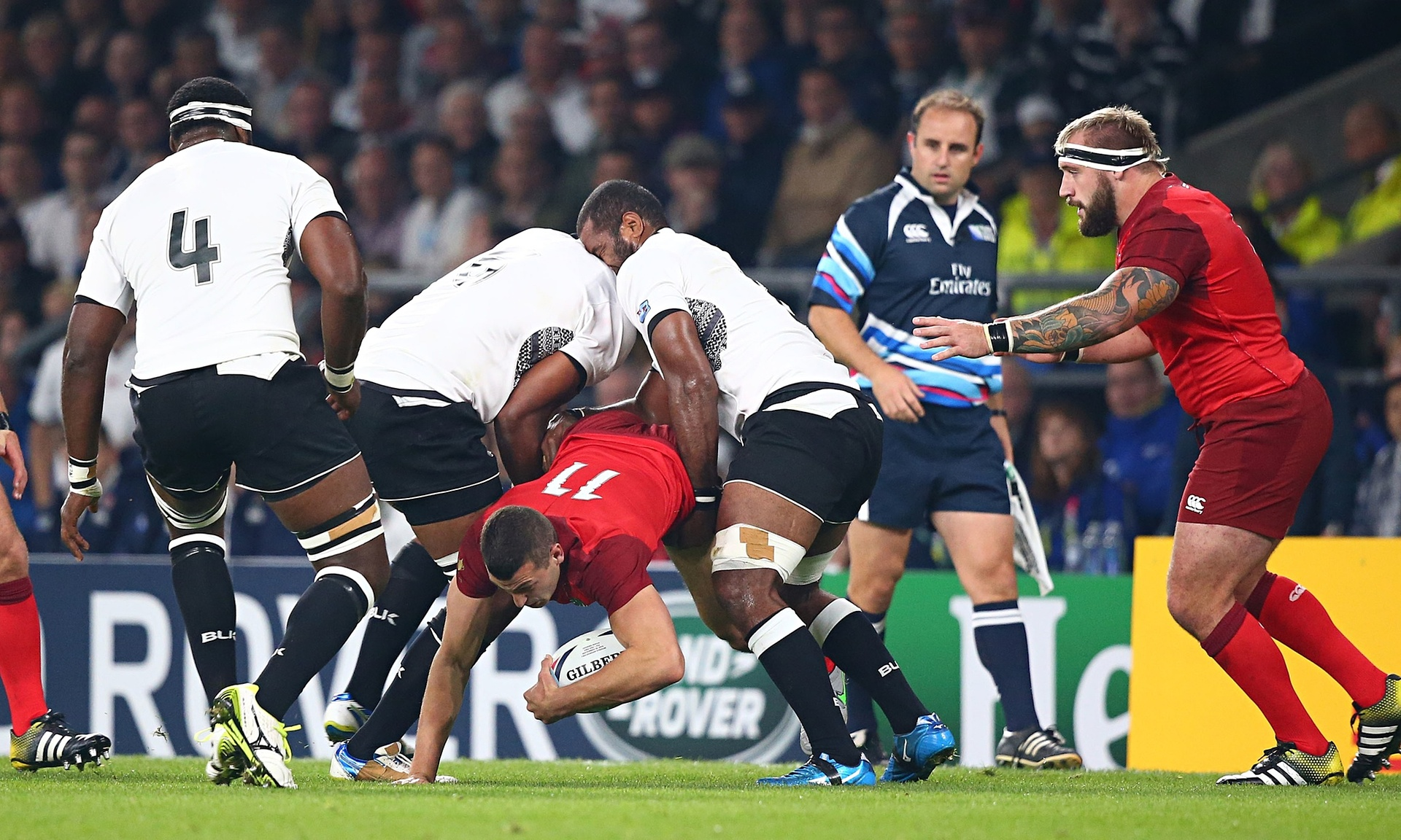 Dominiko Waqaniburotu (2nd left) tip tackles Jonny May in the opening match of the Rugby World Cup. Photo: Matthew Impey/Rex Shutterstock