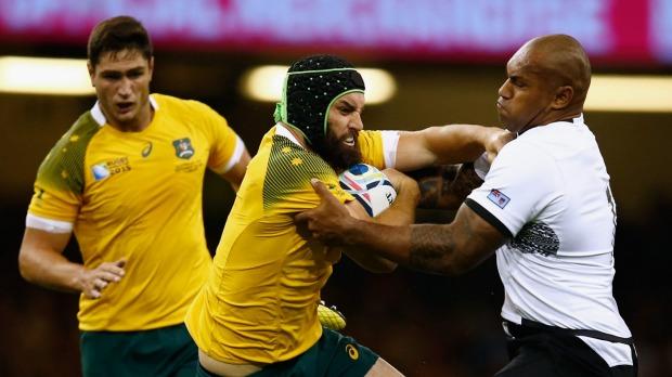 Fiji's Nemani Nadolo (right) tackles Australia's Scott Fardy. Photo: SMH