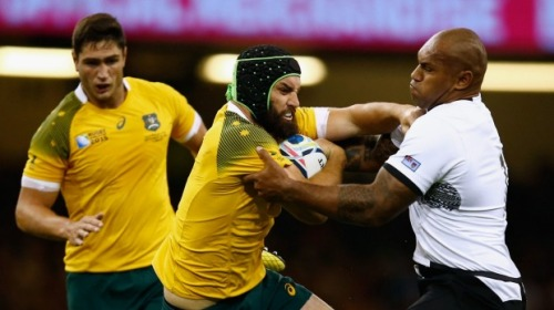 Fiji's Nemani Nadolo (right) tackles Australia's Scott Fardy. Photo: SMH