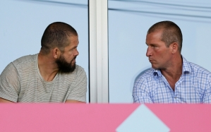 England head coach Stuart Lancaster (right) and backs coach Andy Farrell watch the game from the stands. Photo: Reuters / Henry Browne
