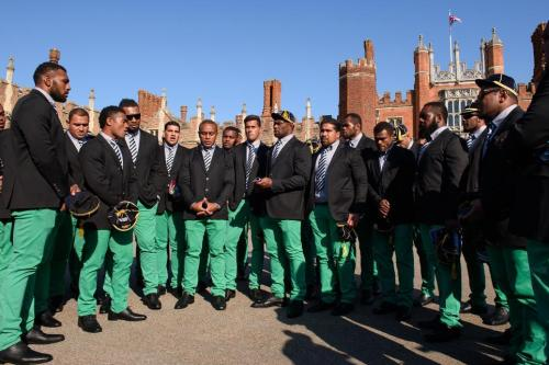 JOLLY GREEN-TROUSERED GIANTS: The Fiji squad sing for tourists at Hampton Court Palace welcome ceremony. Photo: Getty Images