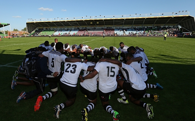 Fiji players form a huddle to pray after the International match between Fiji and Canada at Twickenham Stoop: Photo by Steve Bardens/Getty Images for Harlequins)