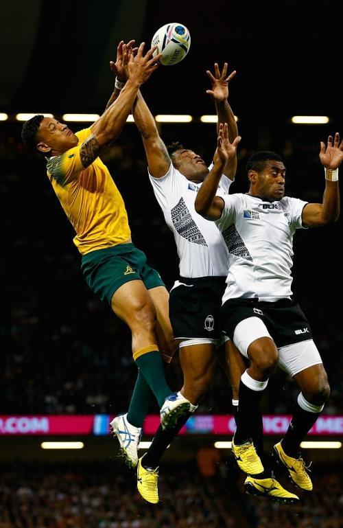Fiji's Metuisela Talebula (centre) and Asaeli Tikoirotuma contest Wallaby Israel Folau for a high ball. Photo: Sky Sports