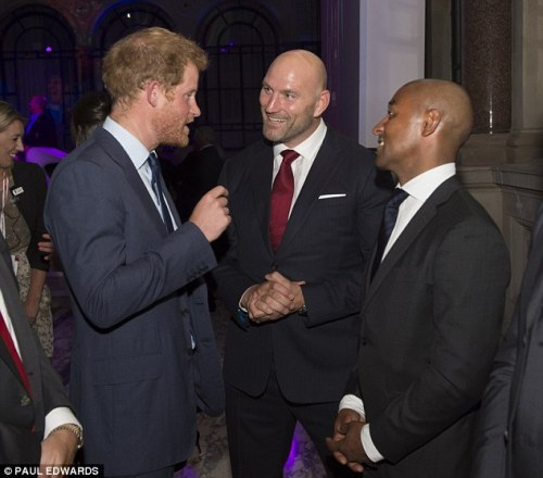 Prince Harry chats with Lawrence Dallaglio and George Gregan in a World Rugby function in London. Photo: Daily Mail