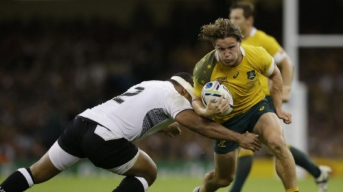 Tuapati Talemaitoga gies in for tackle against Michael Hooper in Fiji's 13-28 loss to Australia yesterday. Photo: SMH