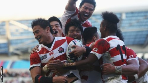 The Japanese side celebrates after the upset defeat of two-time world champions South Africa. Photo: Getty Images