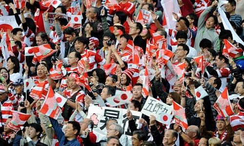 Japanese fans celebrate a famous win over South Africa. Photo: EPA