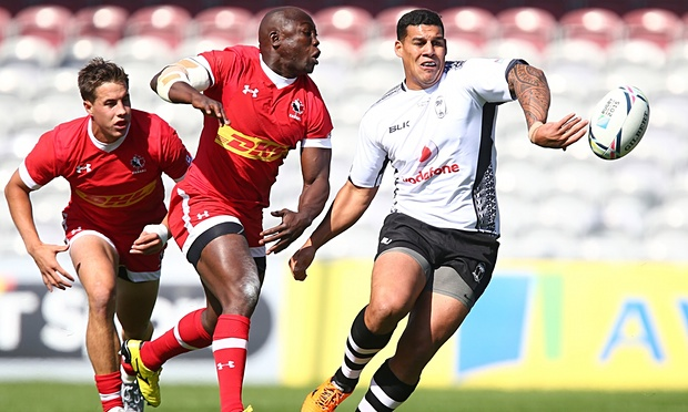Josh Matavesi offloads for Fiji against Canada in a warm up match before the Rugby World Cup.
