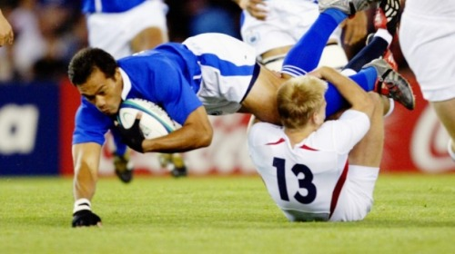 Legend: Brian Lima in action for Samoa in Melbourne during the 2003 World Cup. Photo: Craig Golding, SMH
