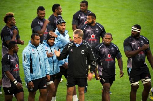 Coach John McKee and skipper Akapusi Qera lead Fiji onto the field for training in France last year. Photo: AFP