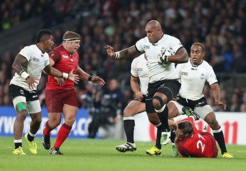 Fiji's Nemani Nadolo runs over Richard Wigglesworth in the RWC opener against England. Photo: WalesOnline