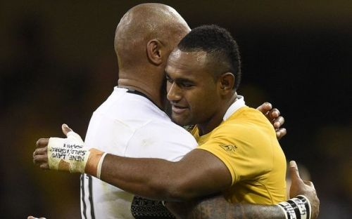 Cousins Fiji's Nemani Nadolo and Australia's Tevita Kuridrani hug after the match in Cardiff. Photo: RadioNZ
