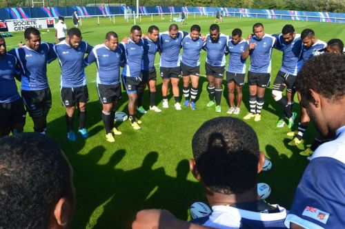 The Fijians open with a prayer for training at the London Irish Rugby Club grounds in London. Photo: Fiji Rugby
